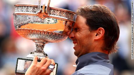 Rafael Nadal raises the French Open trophy for the 12th time after his four-set victory over Dominic Thiem in Paris.
