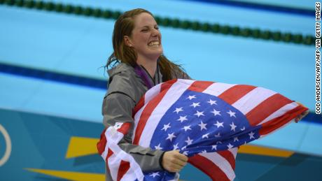 Franklin wears an American flag on the podium after receiving his gold medal for the women's 100-meter backstroke final at the London 2012 Olympic Games.