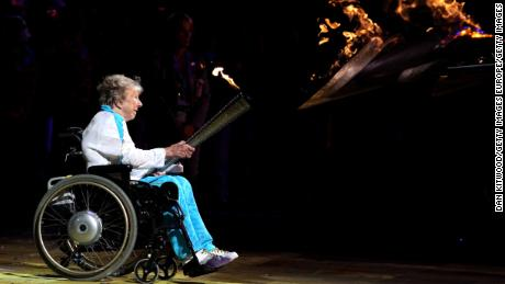 Margaret Maughan lights the Paralympic cauldron before the London 2012 Games.