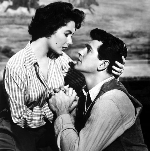 Elizabeth Taylor with Rock Hudson R on the set of Géant directed by George Stevens in 1956 Photo by Apigammagamma Rapho via Getty Images