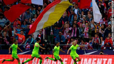 Barcelona forward Toni Duggan (R) celebrates during the Spanish League football match against Atletico.