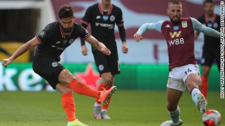 French Chelsea striker Olivier Giroud scores his team's winning goal as his shot diverts the boot from the tough Conor Hourihane to beat Orjan Nyland in the Aston Villa goal.