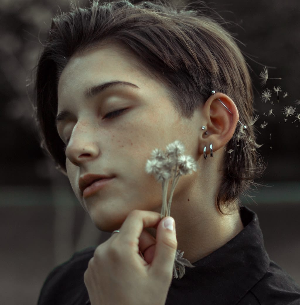 Woman with multiple ear holes