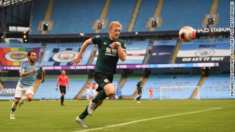 Ben Mee chases the ball in Burnley's 5-0 loss to Manchester City.
