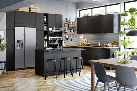 Black wood kitchen with seating