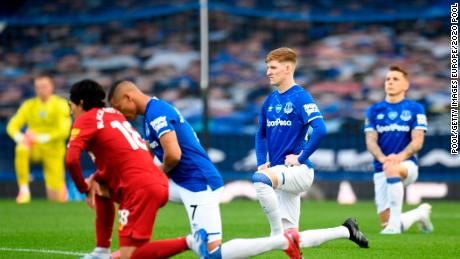 Players and officials take a knee in support of the Black Lives Matter before the Merseyside derby between Everton and Liverpool at Goodison Park.