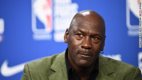 Michael Jordan addresses a press conference before a match between Milwaukee Bucks and Charlotte Hornets.