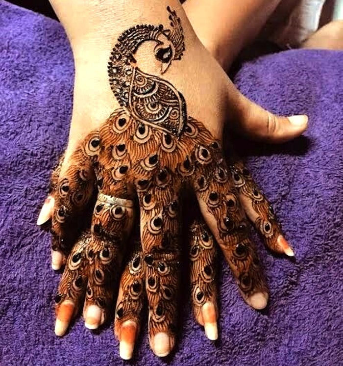 Arabic mehndi pattern with peacock