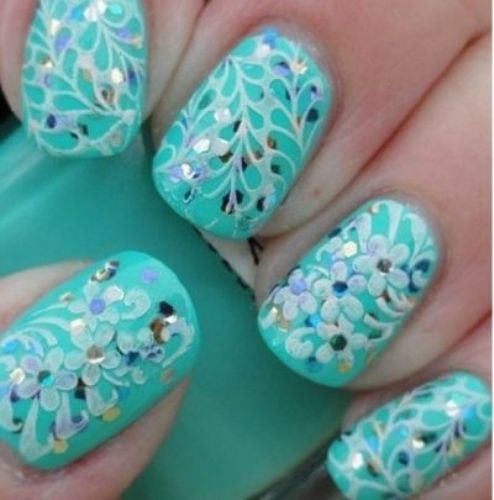 Floral Stamping Patterns Over Turquoise Glitter Nails