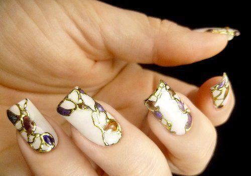 abstract gold foiled nail art design