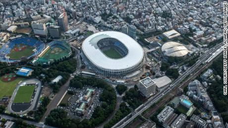 The New National Stadium, the main stadium of the Tokyo 2020 Olympic Games, and the Tokyo Metropolitan Gymnasium (CR) are pictured on July 24, 2019 in Tokyo, Japan.