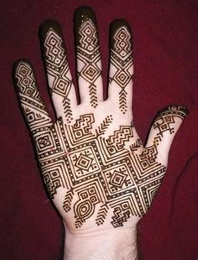 mehendi design with circular patterns