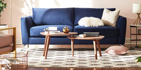 Living room, Furniture, Room, Couch, Interior design, Wall, Coffee table, Table, Yellow, studio couch,