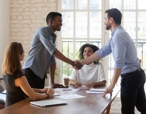 shaking hands after successful negotiation