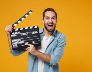 young man with clapboard