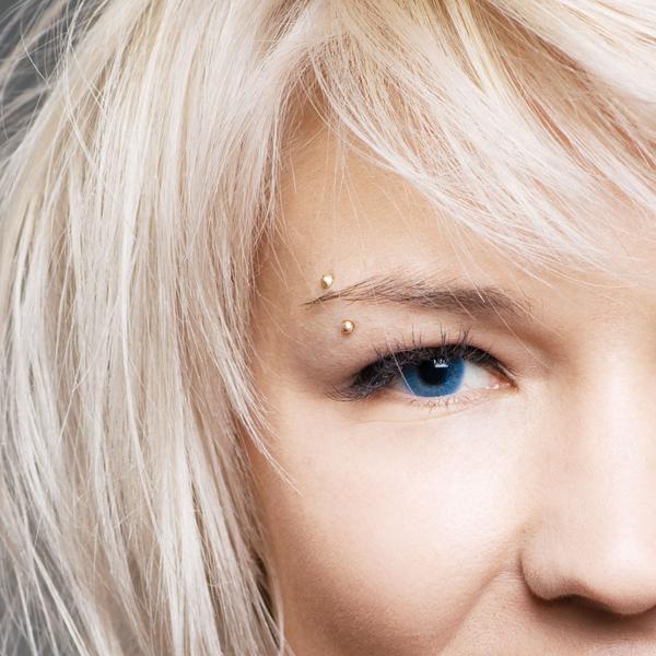 Woman with her eyebrow pierced.