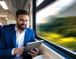 young businessman reading tablet