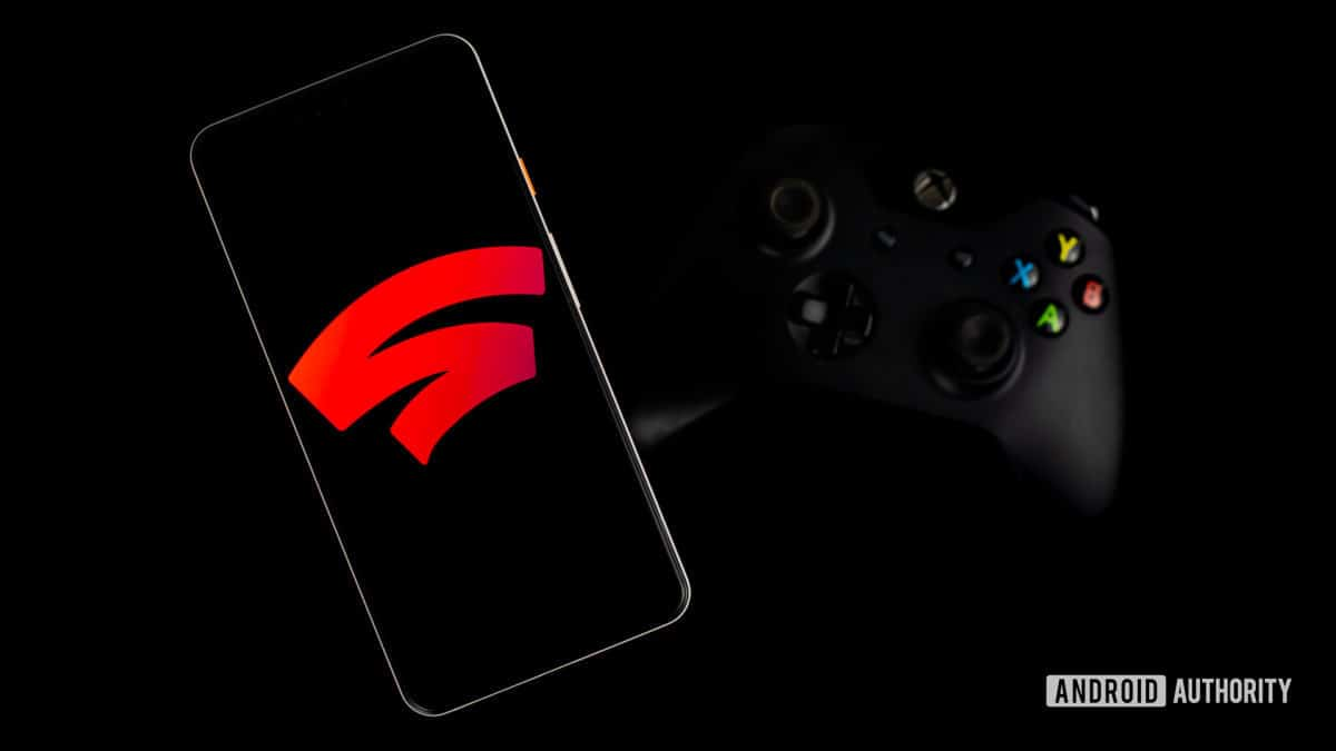 Google Stadia on the smartphone next to the gaming controller Photo 1