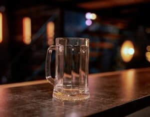 Empty pint lager on wooden table