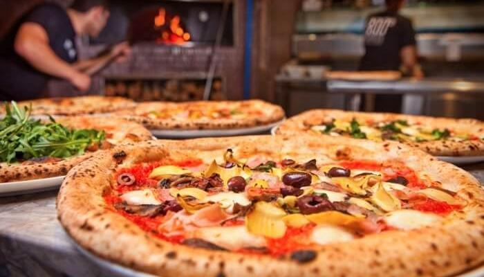 eat different kinds of pizzas at Pizzafest