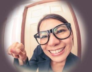 Saleswoman knocking on door