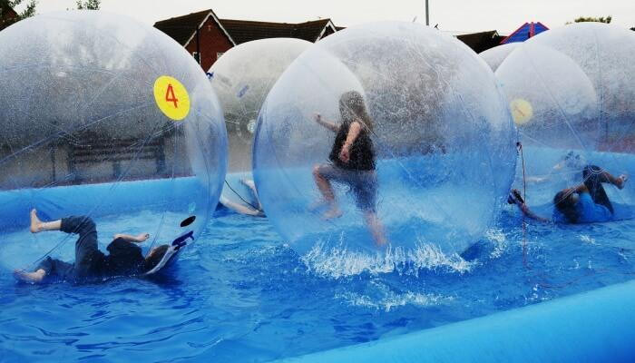 Youth enjoy 'zorbing' at the center