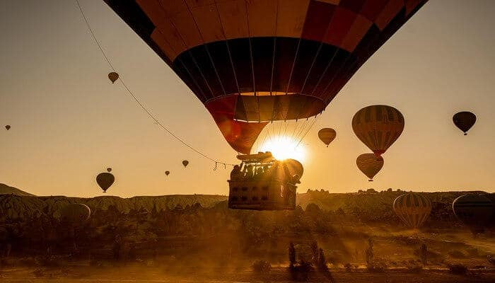 Witness the sunrise from a hot air balloon