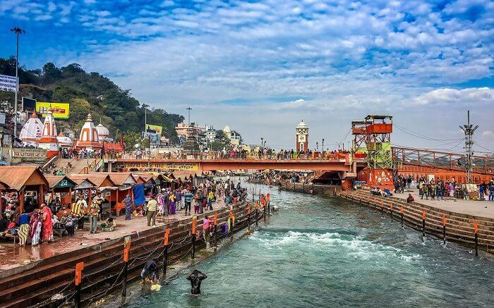 Devotees bathing in the Ganges river at Har ki Pauri in Haridwar