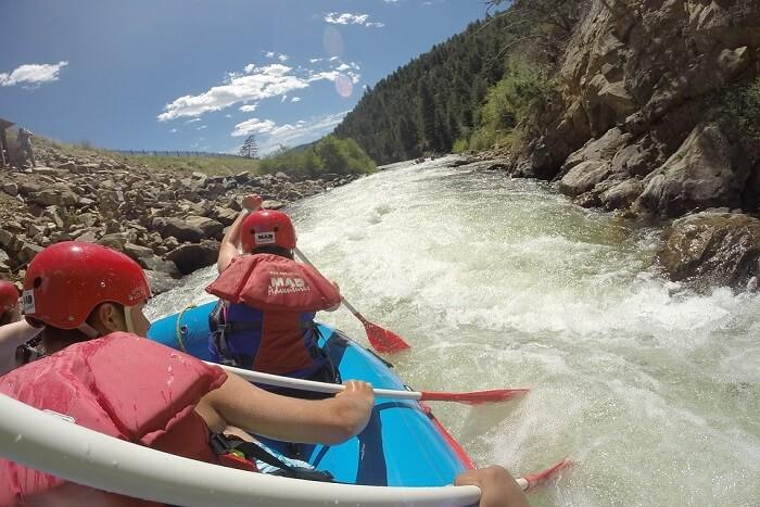 A person rafting in a boat at high speed