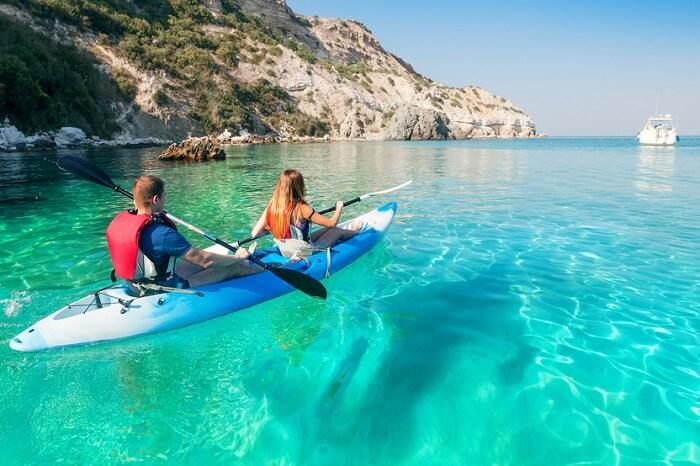A couple takes a sea kayaking trip from Koh Samui