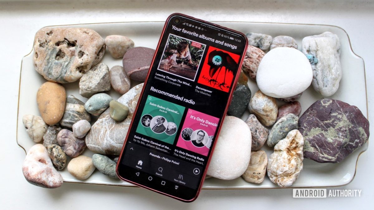 Spotify menu on a smartphone on a bed of rocks