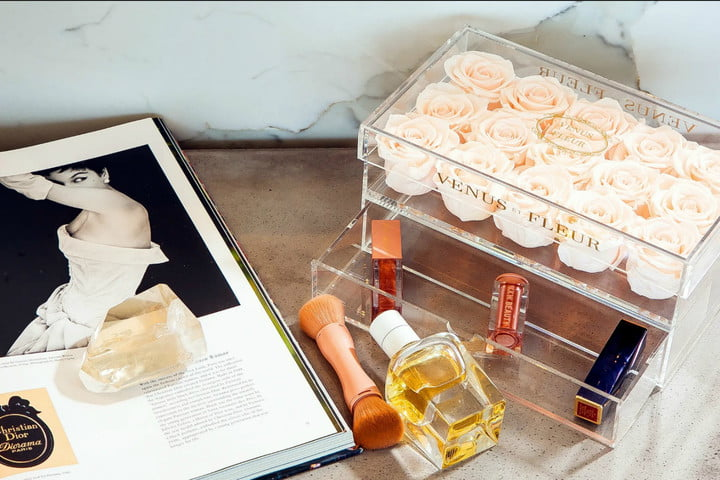 roses in a box with perfume