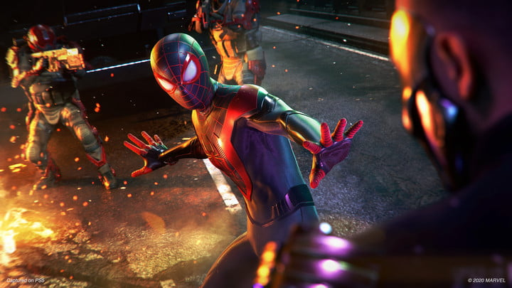 Miles Morales in Spider-Man outfit fending off crime