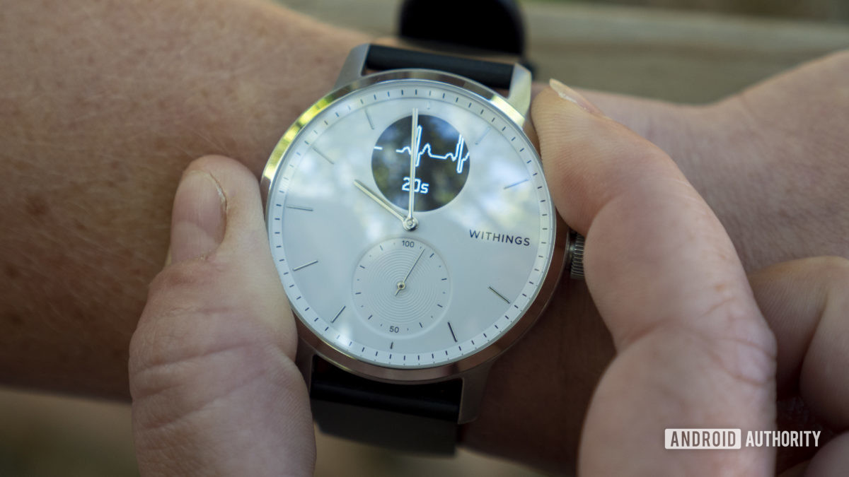 withings scanwatch review taking an ecg recording fingers bezel