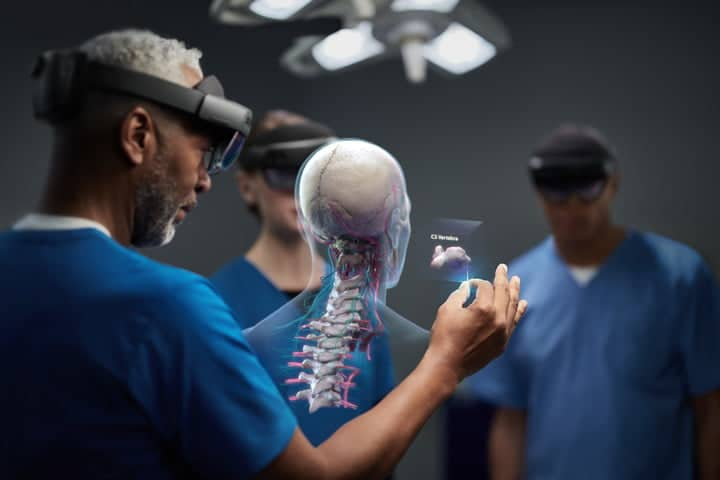 surgeons wear Hololens 2 helmets in the operating room