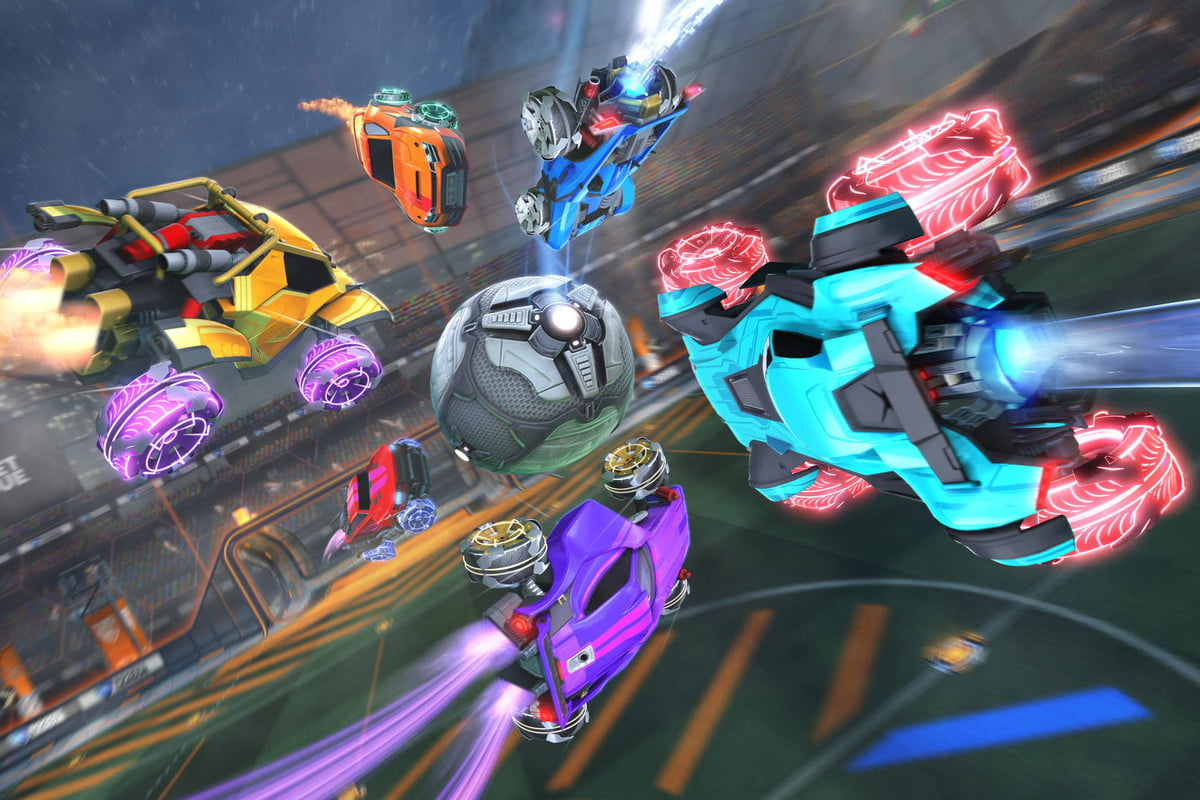 Six cars dive for the ball in a Rocket League match