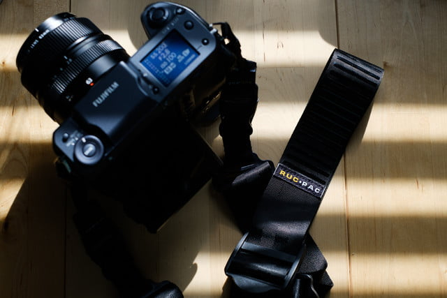 RucPac Slide camera strap attached to Fujifilm GFX 100 camera