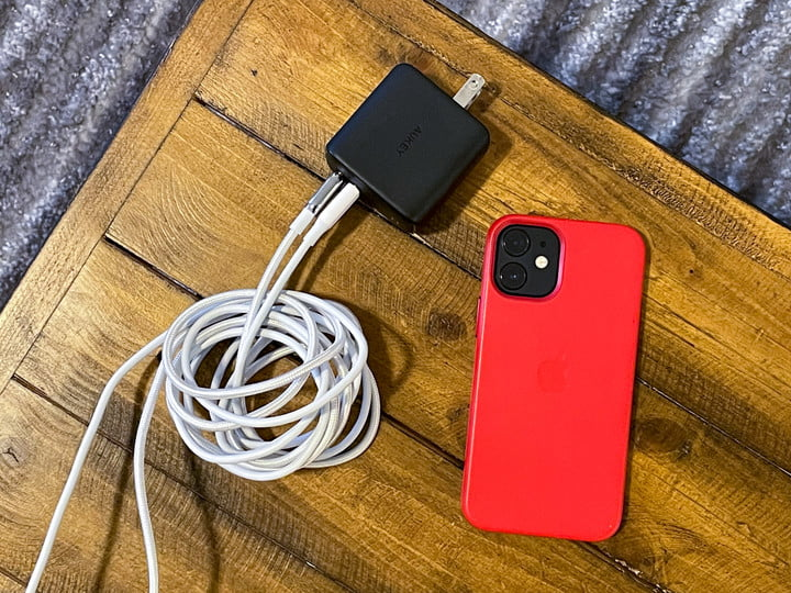 iPhone 12 Mini with charger
