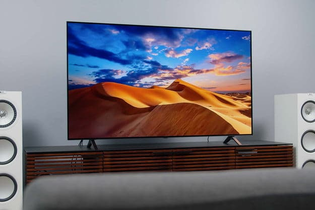 LG A1 OLED 4K HDR TV screen displaying imagery of a colorful desert.