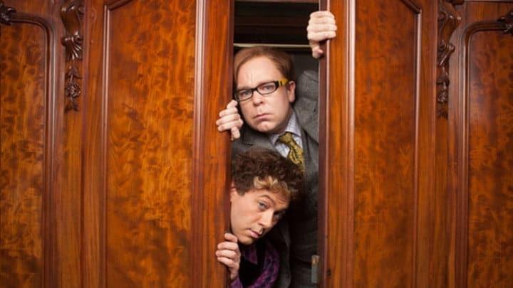 Reece Shearsmith and Steve Pemberton peeking through a set of doors.