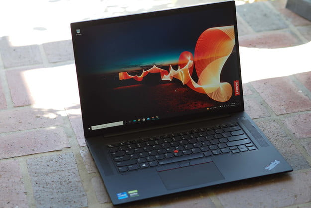 Opened Lenovo ThinkPad X1 Extreme Gen 4 sitting on the ground.