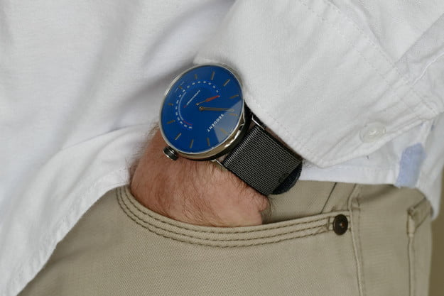 Sequent SuperCharger watch on a wrist with hand in pocket.