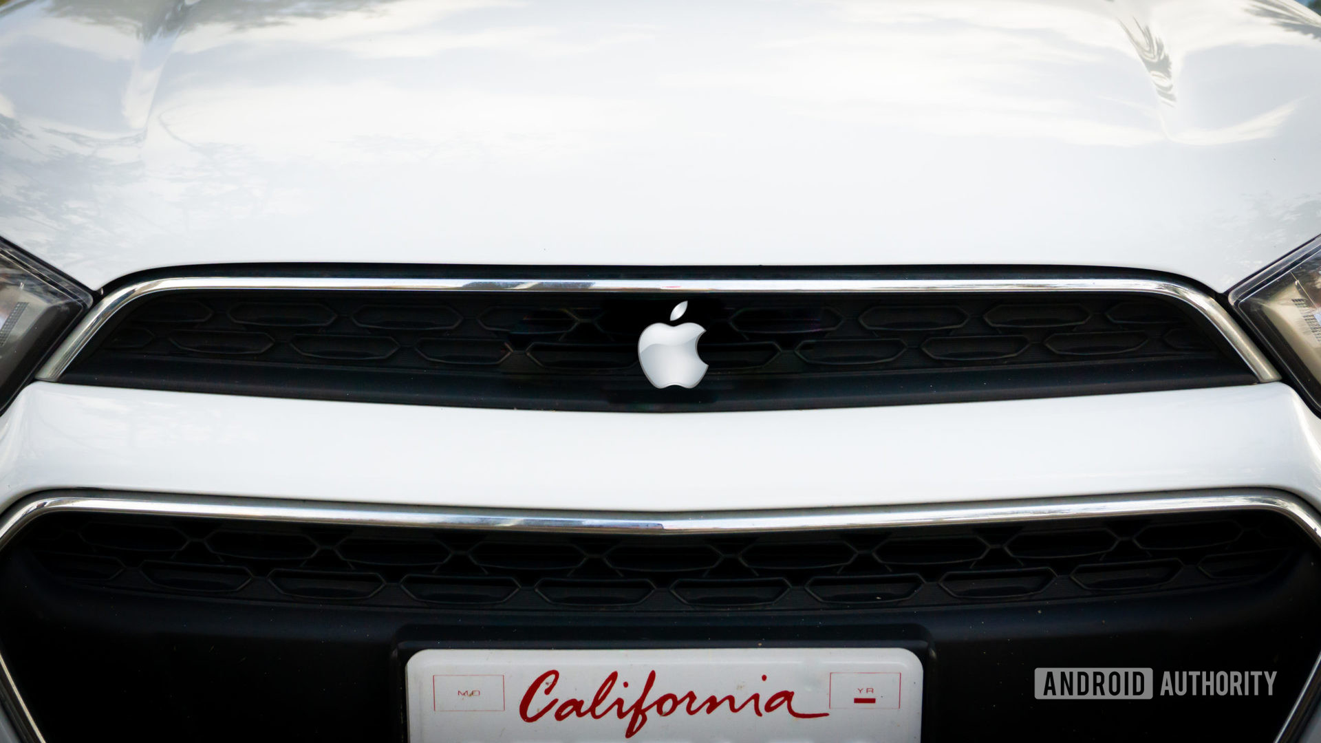 Apple Car Mockup showing front closeup of vehicle with the Apple logo.